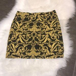 Gold and black skirt size medium